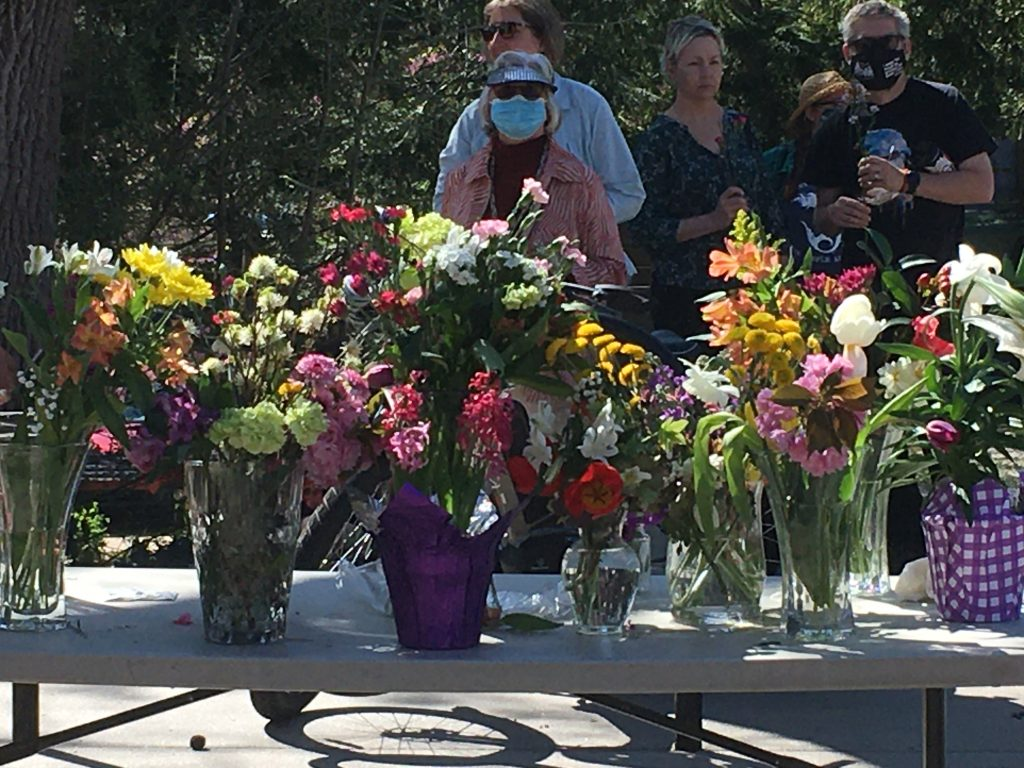 Table showing vases of flowers at a church event