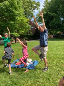 Adult an children stretching/playing