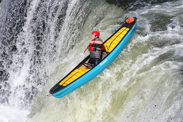 kayaker on a waterfall