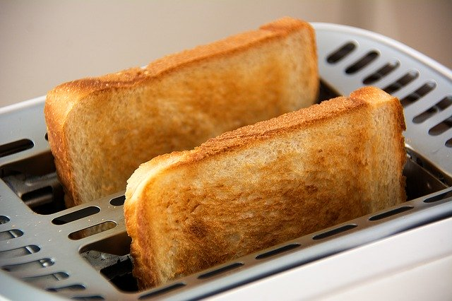 Lovely brown toast coming out of toaster
